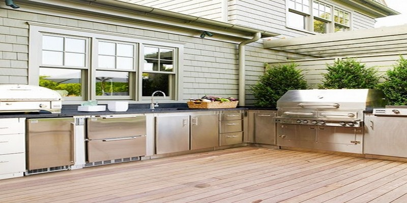 56-Amazing-Outdoor-Kitchen-Designs-with-white-stainless-steel-kitchen-island-sink-oven-stove-grill-machine-window-and-hardwood-floor-and-plant-decor.jpg